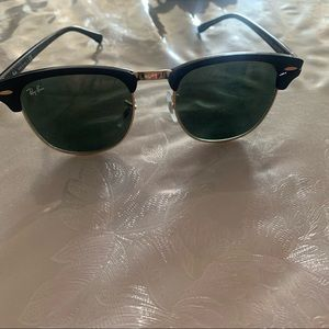 Ray ban sunglasses black and gold trim